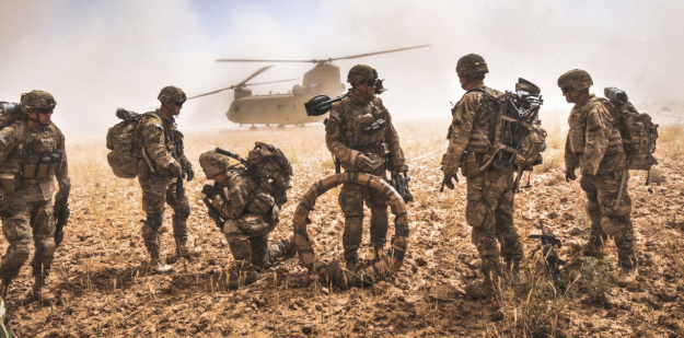 Soldiers standing on helicopter