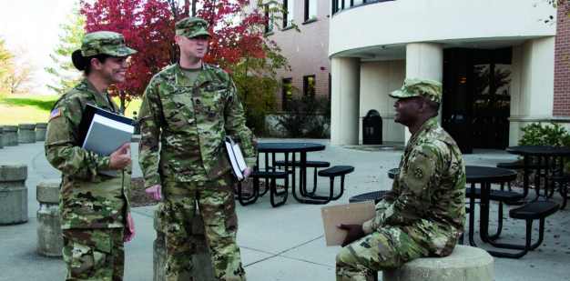 Soldiers talking on a college campus