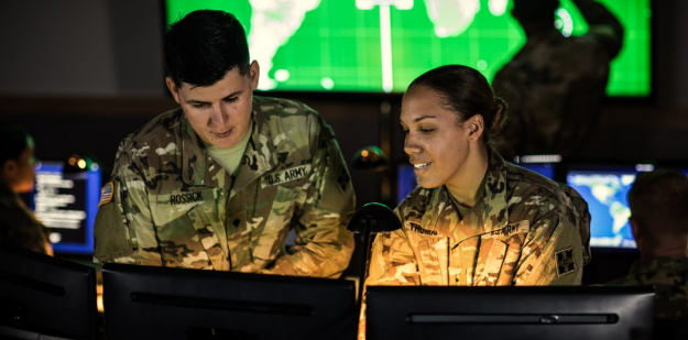 Soldiers working on a computer.