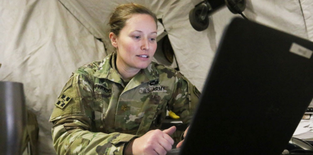 Soldier working on a computer.