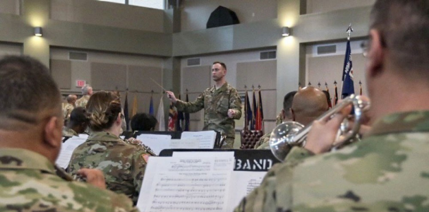 Description: U.S. Army band conductor in the field