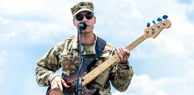 Soldier playing guitar
