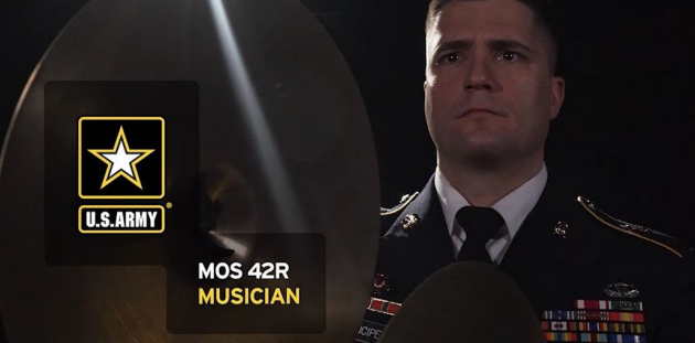 U.S Army band musician plays an electric bass guitar