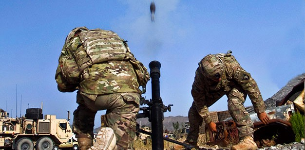 soldier dropping m60 mortar into m224