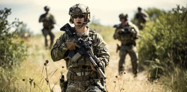 Special Forces Soldiers pulling security during a dismounted reconnaissance.