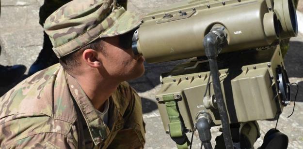 Female soldier repairing