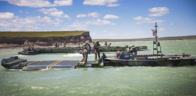 Army Reserve Soldiers disconnecting bridge bays during a training exercise