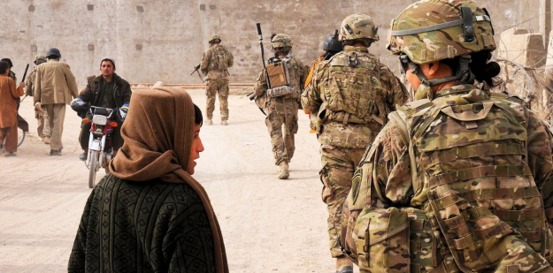 Soldier speaks with a local child during a routine patrol.