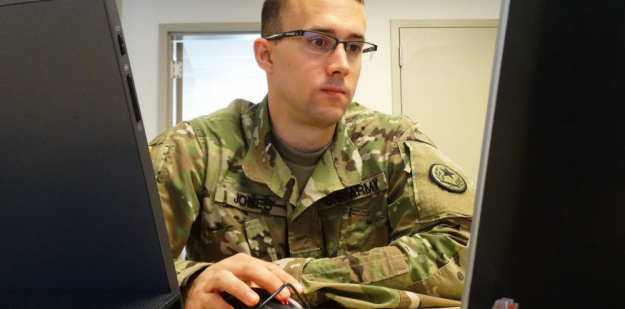 35F Soldier using a computer.
