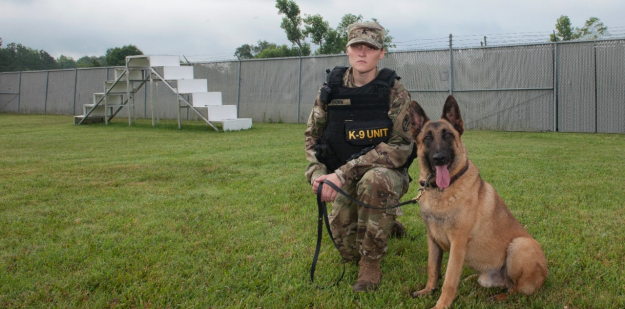 Military Dog Handler with her service dog.