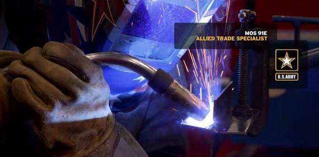 U.S. Army allied trade specialist cutting a steel beam