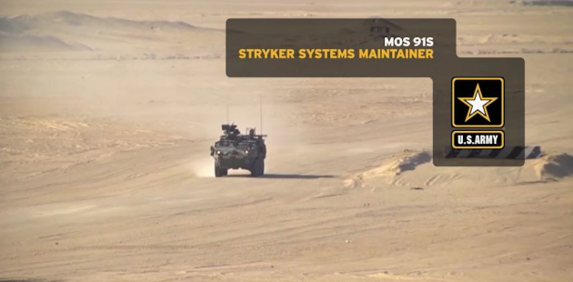 Stryker fighting vehicle systems maintainer working on an engine