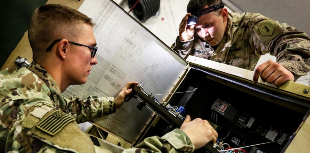U.S. Army Soldier performs maintenance on a generator