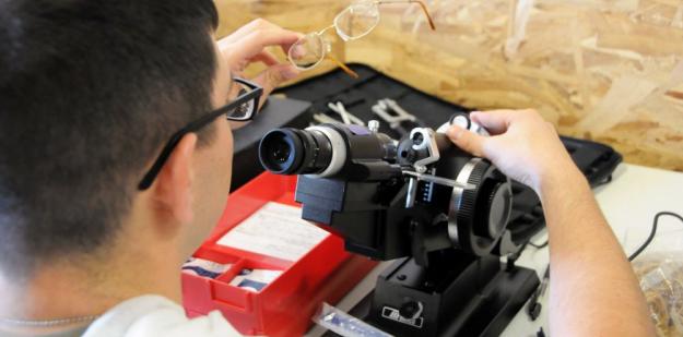 Army AMEDD optometrist examining patient