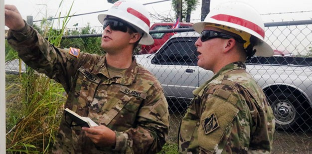 Soldiers assess an area.