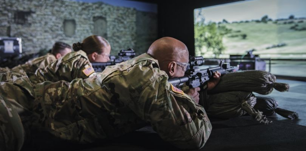 Soldiers conducting weapons simulator training