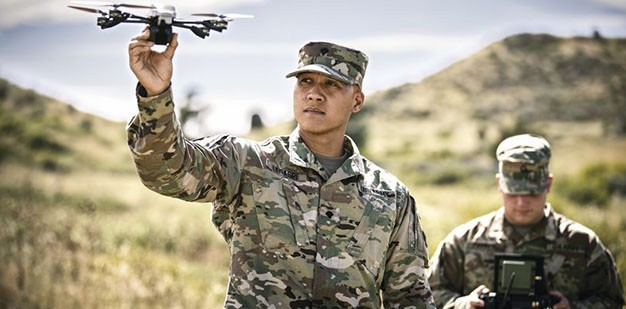 Soldier holding a Unmanned Aerial Vehicle (UAV) Drone