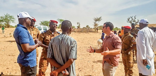 Army personnel conversing with foreign civilians and foreign soldiers