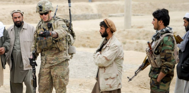 Special Operations Soldier speaks with local citizens.