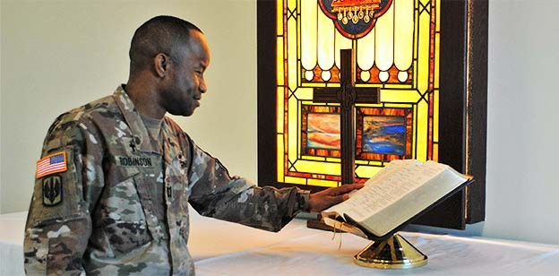 Army Chaplain delivers a Catholic mass
