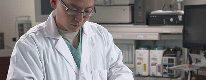 Lt. Col. Kevin Chung examining samples in a lab