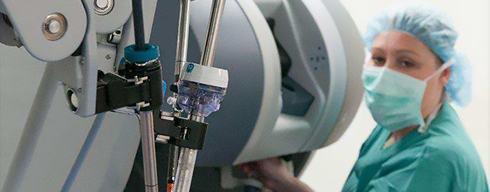 Surgeon using robot to perform operation on a patient