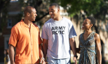 ROTC cadet walks with parents
