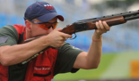 Pfc. Vincent C. Hancock aiming rifle in the olympics