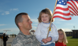 Soldier is greeted by family upon returning from a deployment