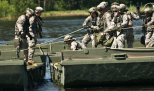 Army Reserve Soldiers work to attach pieces of an improved ribbon bridge