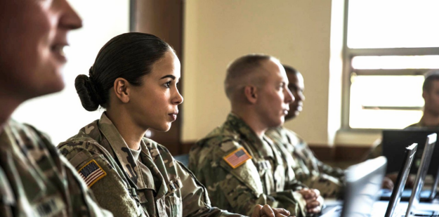 Soldiers sitting in a classroom.
