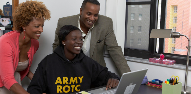 Parents with ROTC cadet at computer