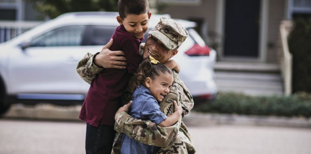 a Soldier is welcomed home by his family