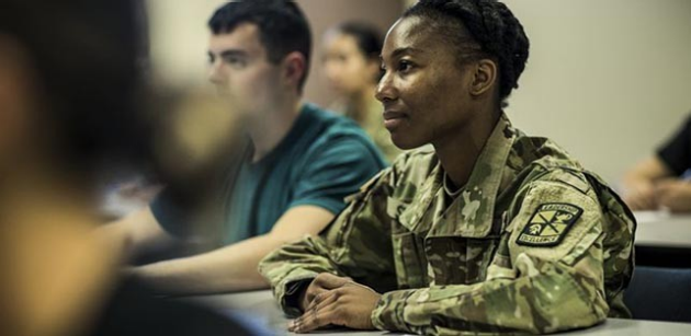 US Army Soldier listening to a lecture in a classroom