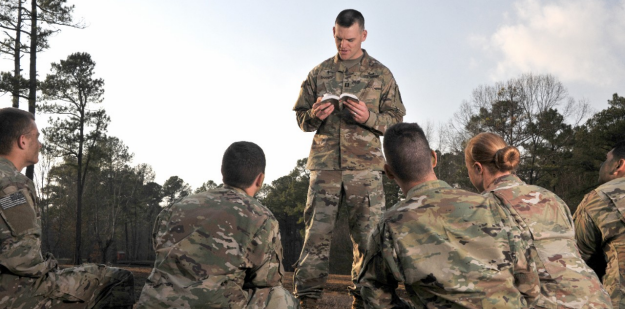 An Army Chaplain ministers to Soldiers.
