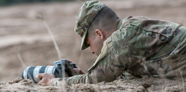 Soldier capturing a photo.