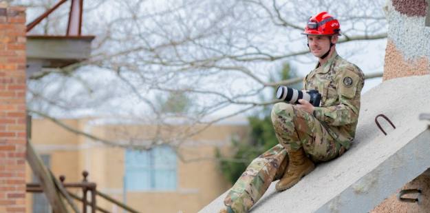 U.S. Army Soldier shoots a video of a neighborhood