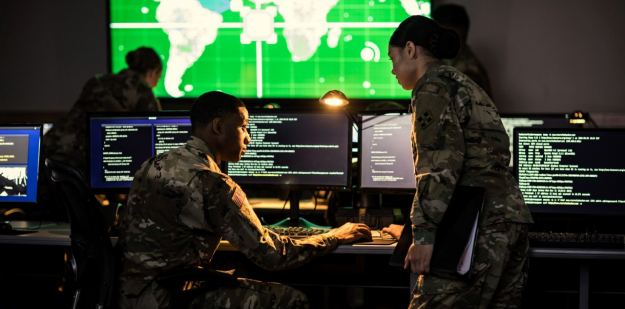 Soldiers inside of a Cyber room.