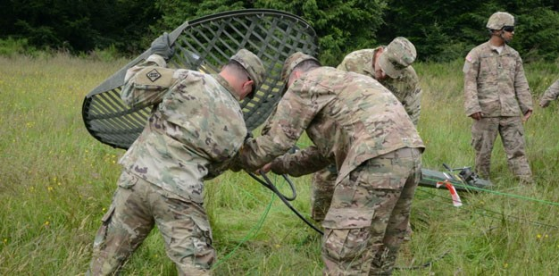 Soldiers setting up a microwave communication system.