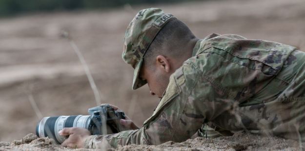Soldier working at two computer screens