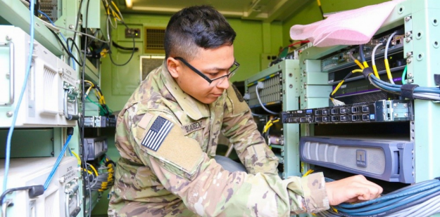 Soldier checking the network status.