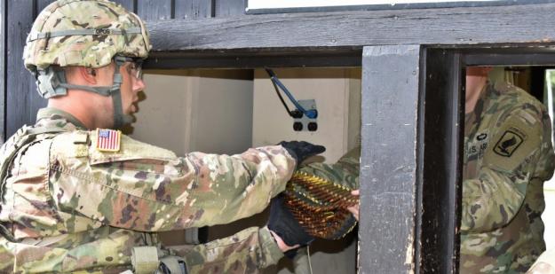 Soldier receives ammunition.