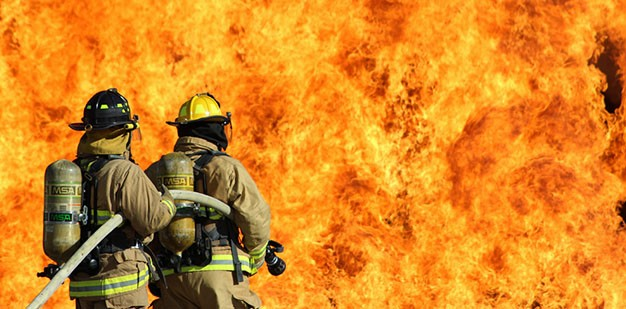 U.S. Army Firefighters putting out a fire.