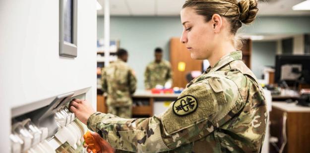 Soldier filling prescription bottle.