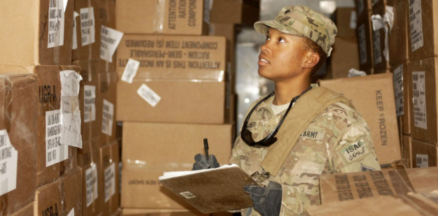 Soldier conducting inventory of a field freezer.