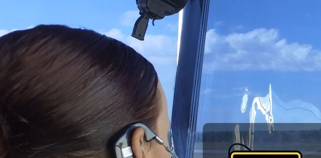 Soldier checking the communication equipment in an AN/TSW-7A mobile air traffic control tower.