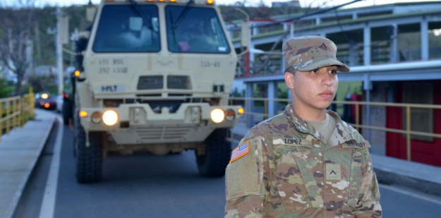 U.S. Army Soldier Staff Sergeant with HEMTT