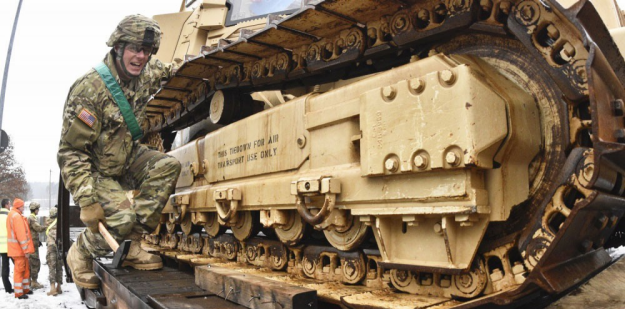 Soldier conducting railway loading operations.