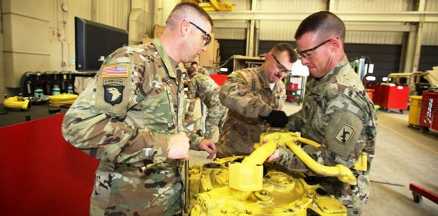 Soldiers working on an engine