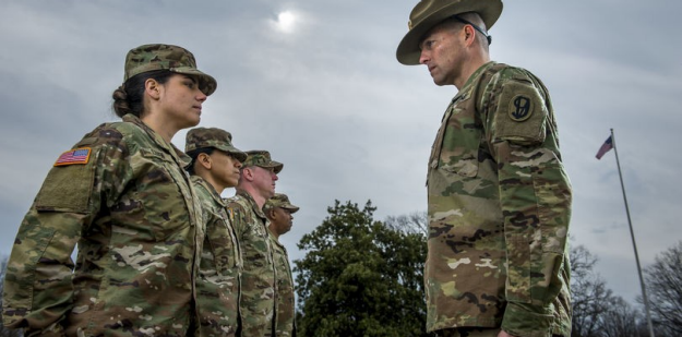 Photo of a Drill Sergeant helping a Soldier